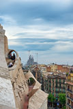 View of Sagrada Familia from Casa Mila, Barcelona. Antoni Gaudi Architecture - View of Sagrada Familia Church in Distance Under Storm Clouds as seen from Rooftop royalty free stock photo