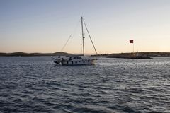 View of a sailboat, Aegean sea and landscape Royalty Free Stock Photos