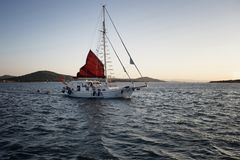 View of a sailboat, Aegean sea and landscape Stock Photos