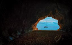 View of sailboat from cave