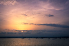 View of Sailboats on Water at Sunset from Ortygia Royalty Free Stock Photos