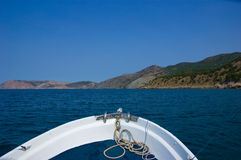 View from sailing boat. Rostrum to sea coast Royalty Free Stock Photography