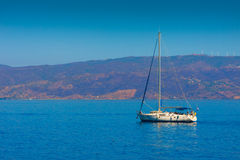 View of sailing boat entering Port Stock Photography