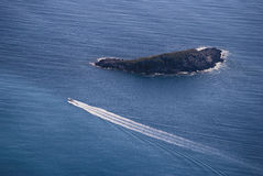 View sailing boat. Sailing boat at open sea, near island Stock Photos