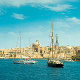 View of sailing boats with Valletta cityscape on the background Royalty Free Stock Image