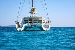 Sailing catamaran in blue waters of the Aegean sea. View of a sailing catamaran in the blue waters of the Aegean sea, Greece Stock Images