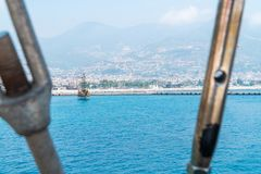 View from sailing ship on the pier near the coastline of Alanya. Royalty Free Stock Photo