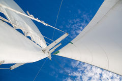 View of the sails and mast against the sky. Stock Image
