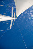 View of the sails and mast against the sky. Stock Photo