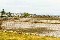 Saint Andrews coast. View of Saint Andrews coast, waterfront and lighthouse at low tide. New Brunswick, Canada royalty free stock photos