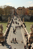 View of Saint Angelo bridge. Sunny day at the Castle Sant Angelo, view of the bridge in front of castle. Tourists taking photos of the scenery. Old Rome can be Royalty Free Stock Photos