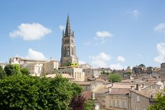 View of Saint Emilion village in Bordeaux region in France. View of French village Saint Emilion dominated by spire of the monolithic church stock photography