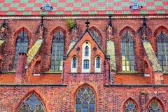 View of Saint Mary Magdalene Church facade. Wroclaw/Poland- August 19, 2017: view of Saint Mary Magdalene Church facade with red, orange and dark bricks wall Royalty Free Stock Photos