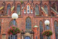 View of Saint Mary Magdalene Church facade. Wroclaw/Poland- August 19, 2017: view of Saint Mary Magdalene Church facade with red, orange and dark bricks wall Stock Photos