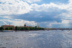 View Saint-Petersburg from the Neva. The Neva river with boats, views of St. Petersburg and the dome of St. Isaac's Cathedral. Picturesque mass of clouds over Royalty Free Stock Images