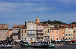 View of Saint Tropez. Marine view of the quay at Saint Tropez with luxury yachts and colorful houses stock photo