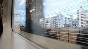 View of Saitama and Tokyo city from Express Electric Railway train stock video footage