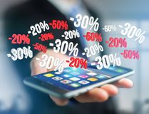 Sales promotion 20% 30% and 50% flying over an interface - Shopp Stock Images