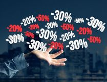 Sales promotion 20% 30% and 50% flying over an interface - Shopp Royalty Free Stock Photography