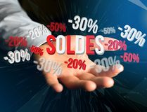 Sales promotion 20% 30% and 50% flying over an interface - Shopp Royalty Free Stock Images