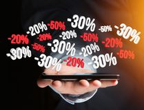 Sales promotion 20% 30% and 50% flying over an interface - Shopping concept. View of a Sales promotion 20% 30% and 50% flying over an interface - Shopping royalty free stock images