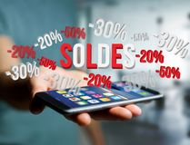 Sales promotion 20% 30% and 50% flying over an interface - Shopp Stock Photos