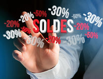 Sales promotion 20% 30% and 50% flying over an interface - Shopping concept. View of a Sales promotion 20% 30% and 50% flying over an interface - Shopping stock photography