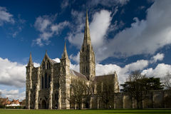 View of Salisbury Cathedral. In England with blue sky and white clouds Stock Photo