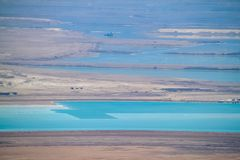View of salt deposits and turquoise blue waters of the Dead Sea in the Judean Desert. Israel stock images