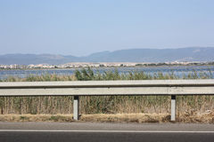 A view of the salt flats from the road. Location Cagliari, Sardinia. A view of the salt flats from the road and mountains on the background. Location Cagliari Royalty Free Stock Image