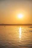 View of the salt lake with a beautiful pink water. Sunset orange sun, the neighborhood.Las salinas, Torrevieja, Spain Royalty Free Stock Photography
