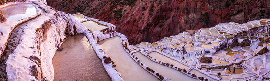 View of salt ponds, Maras, Cuzco, Peru. A salty creek flows through salt ponds near Maras, Peru worked by a cooperative of salt miners Royalty Free Stock Photos