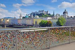 View of Salzburg and the Old Town from the Makartsteg bridge, Ausrtia. Padlocks as a symbol of everlasting love at a Makartsteg bridge  Bridge of Love  over the royalty free stock images