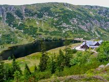 Mountain shelter Samotnia over Mały Staw pond  in Sudetes. View on Samotnia shelter located over Mały Staw pond in Karkonosze National Park in Sudetes in Royalty Free Stock Images