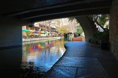View of the San Antonio Riverwalk from under bridge Stock Photos