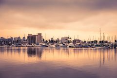 San Diego California evening scene with boats and skyline. View of San Diego California at sunset with boats and buildings seen across the water Stock Photography