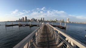 San Diego Bay. The view on San Diego Downtown skyline from the wooden pier with boardwalk on Coronado Island in San Diego Bay. Travel summer destination in stock footage