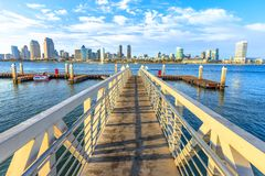 San Diego Bay. The view on San Diego Downtown skyline from the wooden pier with boardwalk on Coronado Island in San Diego Bay. Travel summer destination in stock images