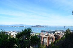 View of San Francisco Bay and Piers. Views of San Francisco Bay, the Bay Bridge, Buildings, and Piers in San Francisco, California Stock Photo