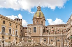 View of San Giuseppe dei Teatini church dome with statue of the Pretoria fountain ahead in Palermo, Sicily. Stock Image