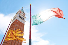 A view of the San Marco campanile and a flag Royalty Free Stock Image