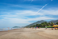 View of sand, sea, forest on the hill and people in a blue sunny day at the beach of Juquey. Stock Images