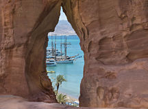 View through the sandstone arch on marina in Eilat Stock Photo