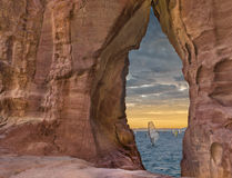 View through the sandstone arch at sunset, Red Sea Royalty Free Stock Photos