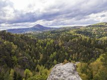View from sandstone pillar on Luzicke hory mountain panorama wit. H dramatic clouds and forests Stock Photo