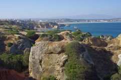 View of sandstone rock formations around Lagos. Portugal with view of long sand stretch of Meia beach Stock Image