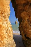 View through a sandstoned natural arch at Camilo Beach  in Lagos, Algarve royalty free stock photo