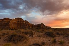 Cloudy sunset behind Toad stool Hoo Doo. View of sandstones in front of the entrance of Toadstool Hoodoos during sunset royalty free stock photo
