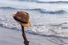 View of the sandy beach with a brown hat on the beach near the s. Ea. The swash of seawater up the beach after the breaking of a wave. Background with copy space Royalty Free Stock Images