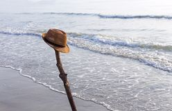 View of the sandy beach with a brown hat on the beach near the s. Ea. The swash of seawater up the beach after the breaking of a wave. Background with copy space Royalty Free Stock Photos